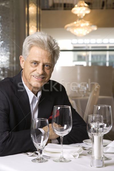 Homme séance restaurant table Photo stock © iofoto