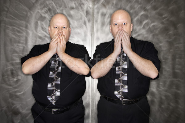 Twin men covering mouth. Stock photo © iofoto