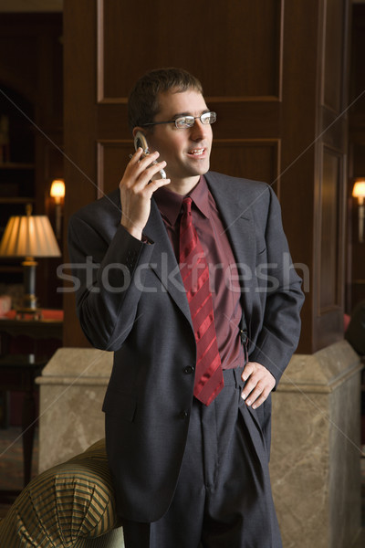 Businessman on cell phone. Stock photo © iofoto
