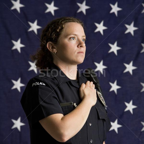 Patriótico mujer policía retrato adulto caucásico bandera de Estados Unidos Foto stock © iofoto