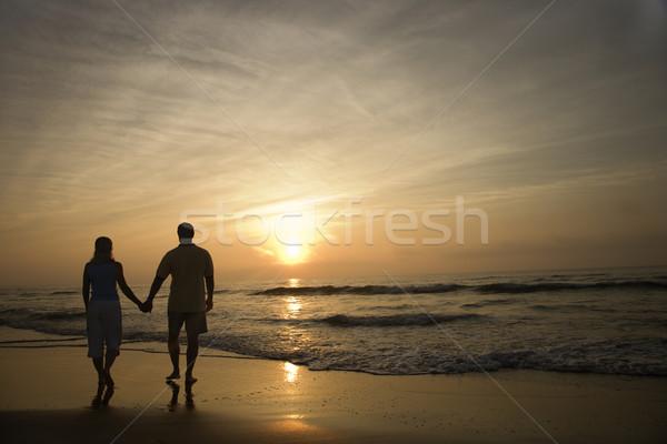 Stock photo: Couple Walking on Beach at Sunset