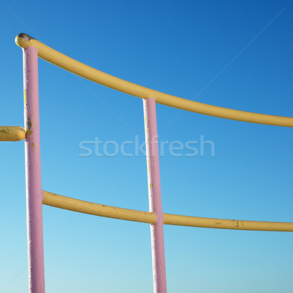 Pink and yellow railings. Stock photo © iofoto