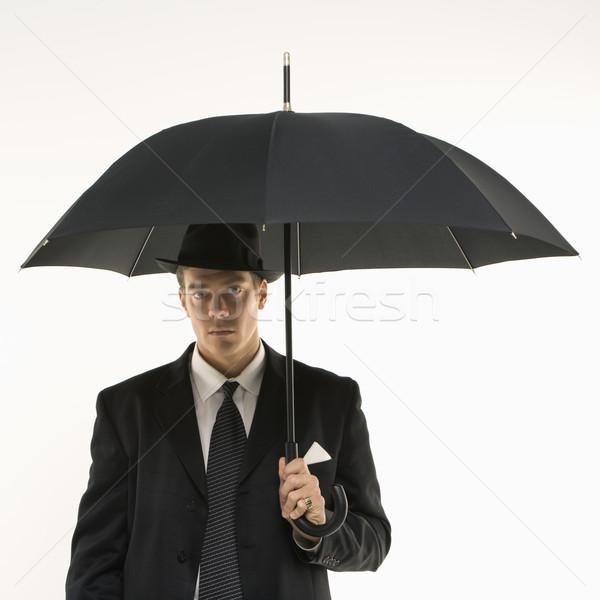 Empresario paraguas caucásico fedora Foto stock © iofoto