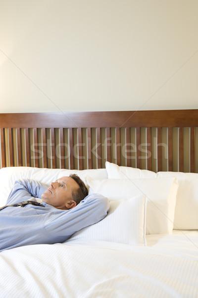 Işadamı rahatlatıcı yatak kafkas yukarı tavan Stok fotoğraf © iofoto