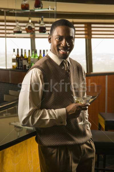 Homem potável martini africano americano adulto bar Foto stock © iofoto