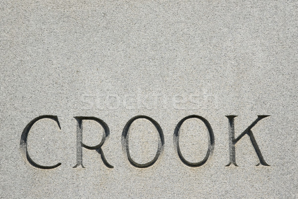 Word 'crook' on gravestone. Stock photo © iofoto