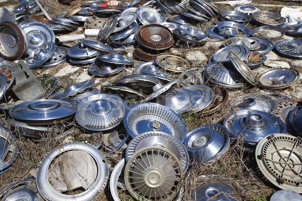 Old hubcaps on ground Stock photo © iofoto