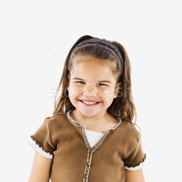 Peu souriant hispanique fille cute permanent Photo stock © iofoto