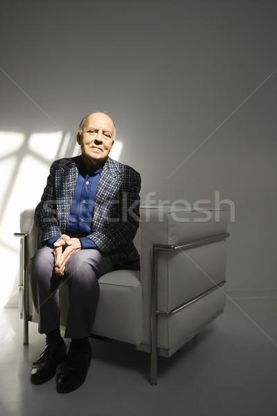 Férfi ül szék kaukázusi középkorú felnőtt férfi Stock fotó © iofoto