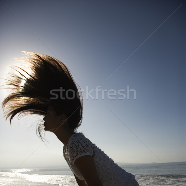 Woman swinging hair. Stock photo © iofoto