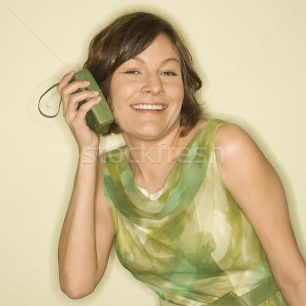 Stock photo: Woman listening to music.