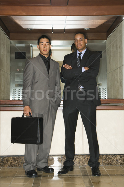Two Businessmen Standing in Lobby Stock photo © iofoto