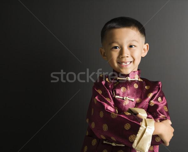 Uśmiechnięty asian chłopca tradycyjny stałego Zdjęcia stock © iofoto