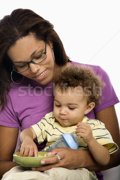 Mother feeding child. Stock photo © iofoto