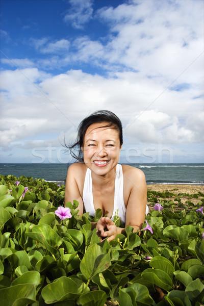 Woman Lying in Plants Near Beach Stock photo © iofoto