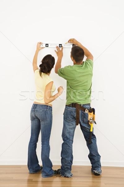 Couple leveling. Stock photo © iofoto