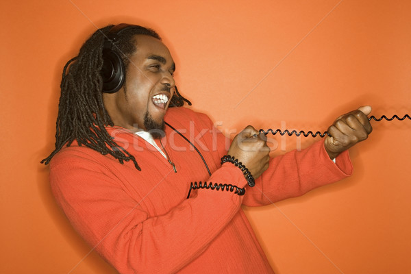 Man pulling cord. Stock photo © iofoto
