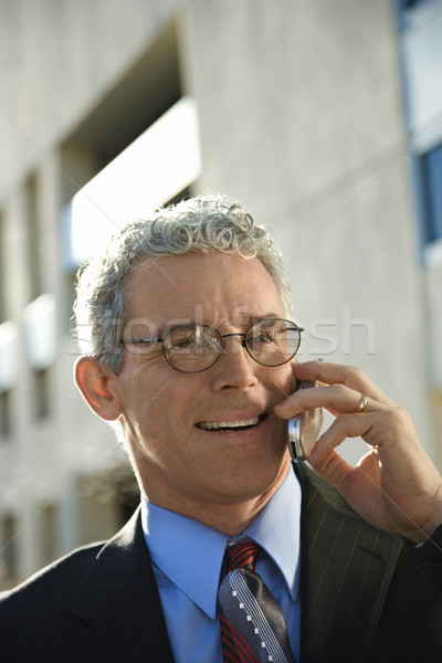 Man on cellphone. Stock photo © iofoto