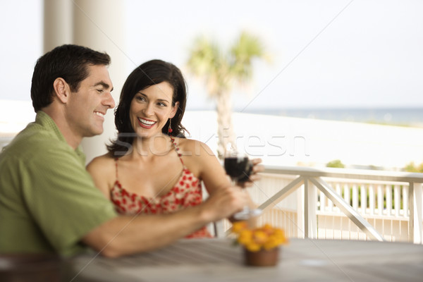 Couple Drinking and Smiling Stock photo © iofoto