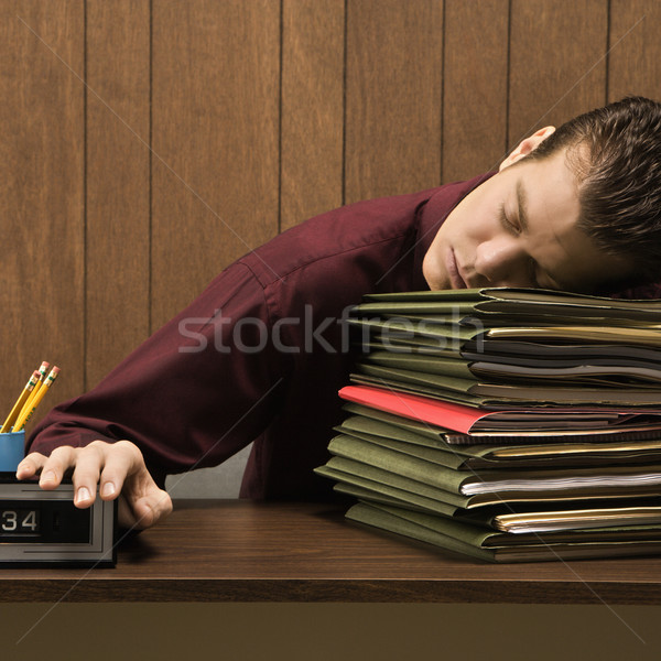 Businessman sleeping. Stock photo © iofoto