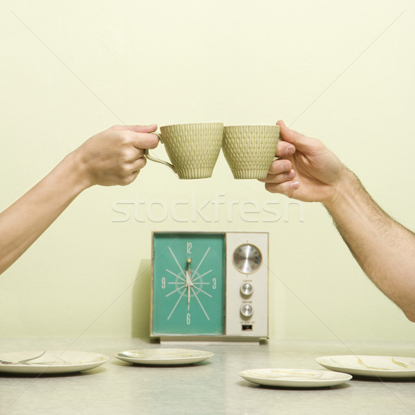 Stock photo: Hands toasting cups.