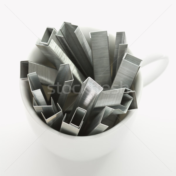 Staples in coffee cup. Stock photo © iofoto