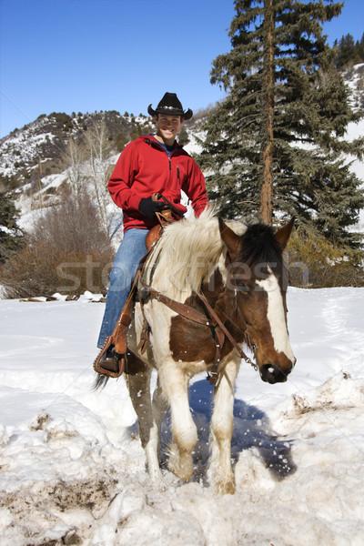 Férfi lovaglás hó fiatal kaukázusi hegyek Stock fotó © iofoto