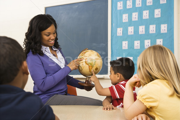 Teacher Holding Globe Stock photo © iofoto