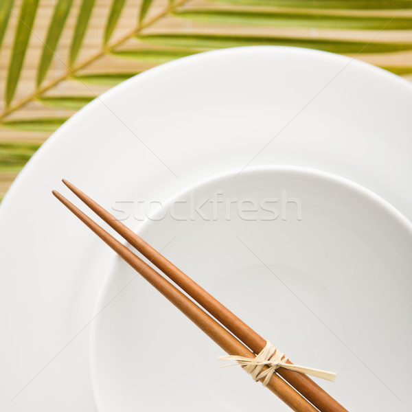 Chopsticks on an Empty Bowl Stock photo © iofoto