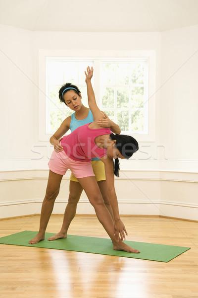 Yoga instructor helping student Stock photo © iofoto
