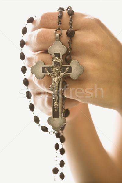 Mulher crucifixo mãos rosário mão Foto stock © iofoto