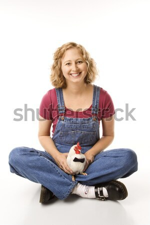 Woman holding rooster wearing tie. Stock photo © iofoto