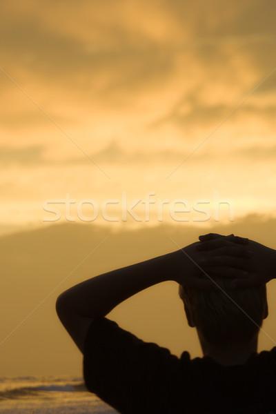 Boy on beach at sunset Stock photo © iofoto