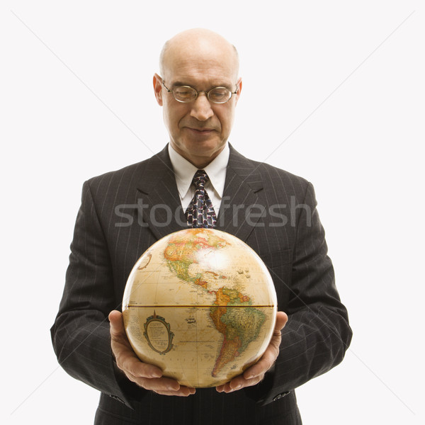Businessman holding globe. Stock photo © iofoto