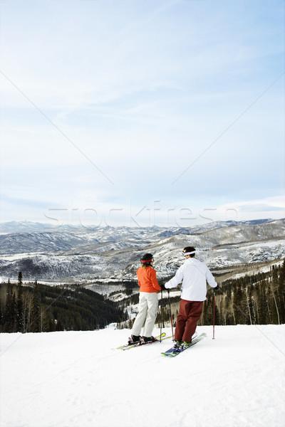 Skiers on Mountain Overlooking Valley Stock photo © iofoto