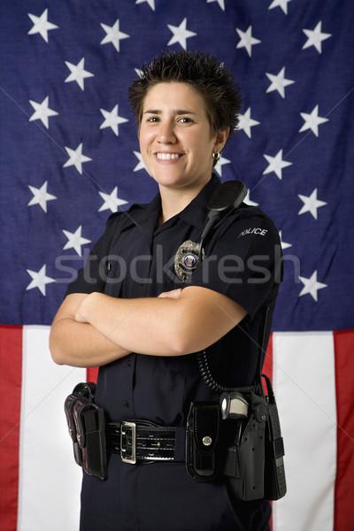 Mujer policía bandera retrato adulto caucásico pie Foto stock © iofoto