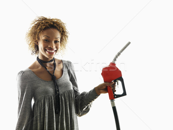 Nő tart benzinpumpa fúvóka portré csinos Stock fotó © iofoto