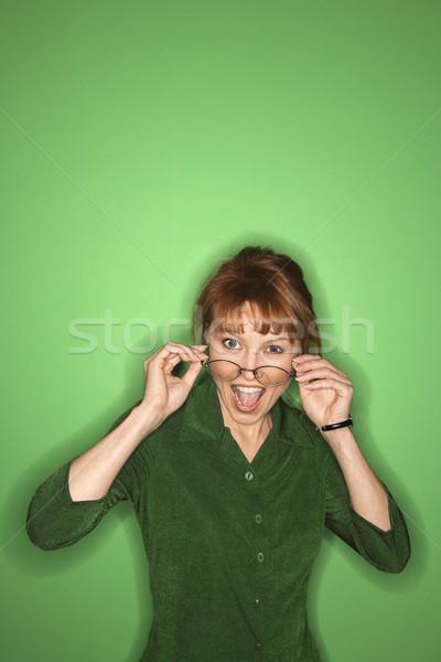 женщину очки улыбаясь кавказский зеленый цвета Сток-фото © iofoto