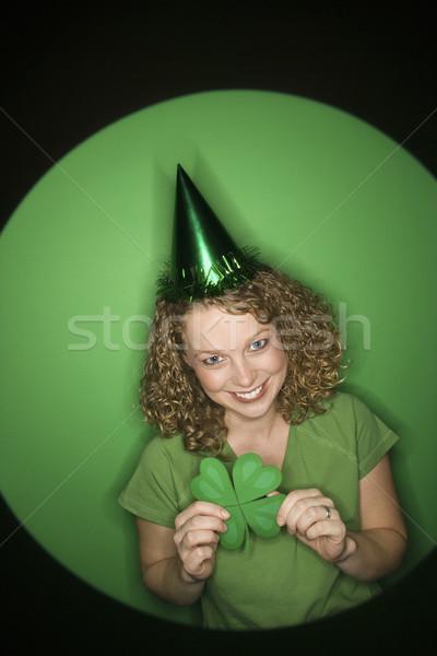 Woman holding shamrock. Stock photo © iofoto