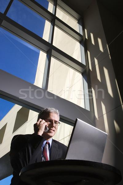 бизнесмен портативного компьютера говорить сидят большой Сток-фото © iofoto