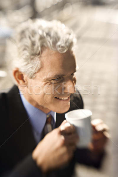 Businessman drinking coffee. Stock photo © iofoto