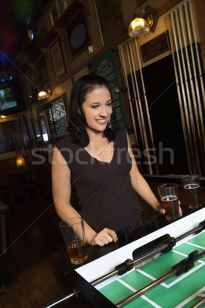 Young woman playing foosball. Stock photo © iofoto
