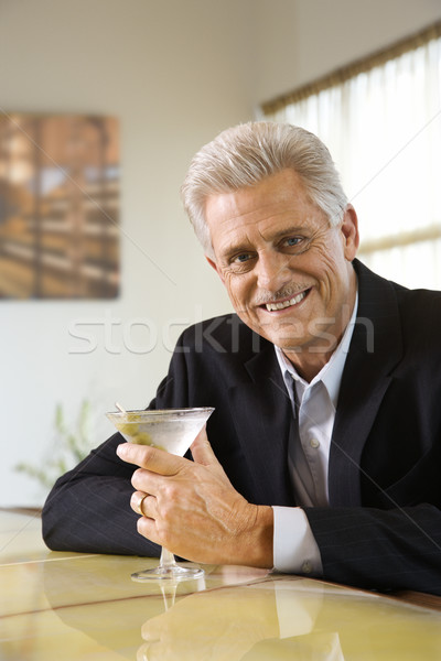 Man at bar with martini. Stock photo © iofoto