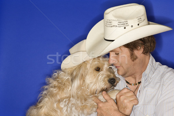 Dog and man in cowboy hats. Stock photo © iofoto