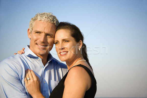 Smiling Couple Embracing Stock photo © iofoto