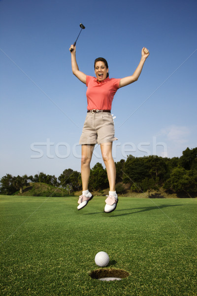 Happy woman golfing. Stock photo © iofoto