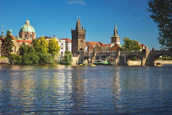 Eski şehir merkezinde Prag nehir köprü gökyüzü Stok fotoğraf © Ionia