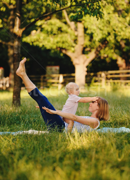 Mother and her daugther practice yoga Stock photo © Ionia
