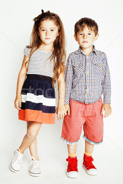 little cute boy and girl hugging playing on white background, happy smiling family, lifestyle people Stock photo © iordani