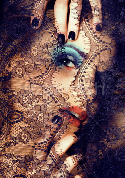 portrait of beauty young woman through lace close up mistery makeup Stock photo © iordani